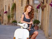 pic of scooter  - Young beautiful italian woman sitting on a italian scooter - JPG