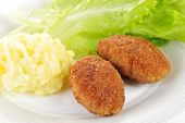 stock photo of pork cutlet  - roasted cutlets of pork with potato and lettuce - JPG