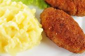 pic of pork cutlet  - roasted cutlets of pork with potato and lettuce - JPG