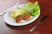 image of pork cutlet  - roasted cutlets of pork with potato and lettuce - JPG