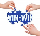 stock photo of win  - Hands with puzzle making WIN - JPG