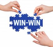 pic of win  - Hands with puzzle making WIN - JPG