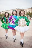 picture of wig  - Three women in irish dance dresses and wig posing outdoor - JPG