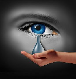 foto of depressed  - Depression support and therapy concept as a depressed human eye crying a tear held by a helping hand as a metaphor for solutions in the the treatment of mental health issues through psychotherapy or medication - JPG