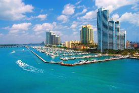 stock photo of boat  - jet ski and boat sailing next to South Miami Beach - JPG