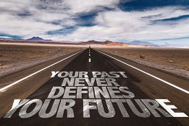 picture of past future  - Your Past Never Defines Your Future written on desert road - JPG
