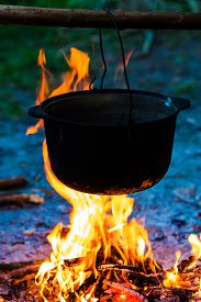 picture of cauldron  - huge copper cauldron with the tasty mulled wine cooked over the open fire - JPG