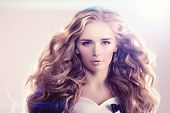 Model with long hair Blonde Waves Curls Hairstyle Hair Salon Updo Fashion model with shiny hair Woma poster