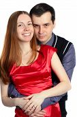 Young Man Embraces Beautiful Woman In Red.