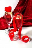 Champagne With Red Ribbon And Heart