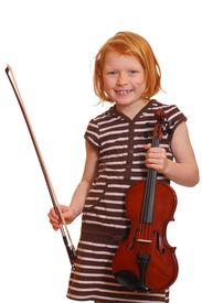 stock photo of musical instrument string  - a portrait of a young girl holding her violin - JPG