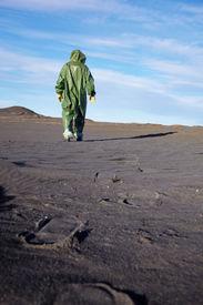 stock photo of scoria  - The scientific ecologist in overalls leaves afar - JPG