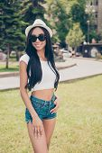 Attractive Cute Carefree Gorgeous Lady With Bronze Skin Is Posing In Sunny Town, On Stroll, In Eyewe poster