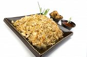 image of lumpia  - Pancit on a ceramic dish with egg rolls and sweet and sour sauce - JPG