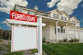 Blank Foreclosure Sign And House