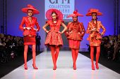 MOSCOW - FEBRUARY 22: Four women wear red suits from Slava Zaytzev walk the catwalk in the Collectio