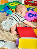 Child jigsaw develops children. Family puzzle making mother and baby. Mom holding big pieces helping poster