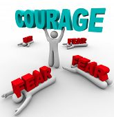 One person stands holding the word Courage, having conquered his fear, while others around him succu