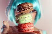 stock photo of asian woman  - A young woman loves her sweet macaron - JPG