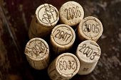 Close up shot of a collection of generic corks from Bordeaux red wine region, focus on the vintage 2003-2009