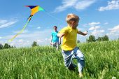 stock photo of kites  - father with son in summer playing with kite