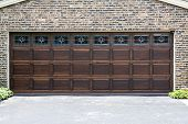 stock photo of garage  - Dark Wooden Garage Door with brick wall background - JPG