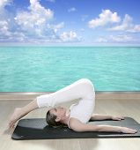 image of saxy  - black mat yoga woman window turquoise sea view tropical caribbean - JPG