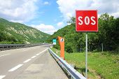 Emergency Phone And Sos Sign On Road
