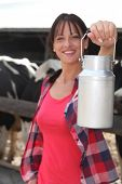 picture of milkmaid  - female farmer milking the cows - JPG