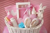Wicker basket with baby shower gifts indoors poster