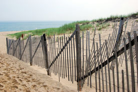 stock photo of cape-cod  - Cape Cod beach landscape with wood fence - JPG