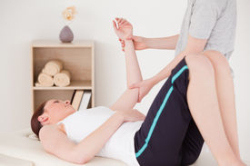 picture of tennis elbow  - Young woman having an arm massage in a centre - JPG