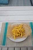 French Fries On Paper And On A Plate In A Cafe. French Fries, Pub, Heat. Potato. poster