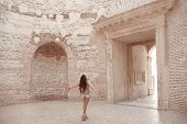 Girl Traveller Enjoying Sightseeing Interior Door Vestibule Of The Diocletians Palace In Old City C poster