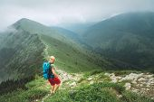 Backpacker Hiker Man Walking By The Foggy Cloudy Weather Mountain Range Path With Backpack. Active S poster