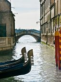 Prows Of Two Gondolas In Venice