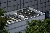 Commercial Cooling Hvac Air Conditioner Condenser On Large Commercial Building Rooftop For Climate C poster