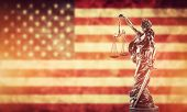 Law concept. Themis statue against USA flag. Symbol of justice, court, trial. poster