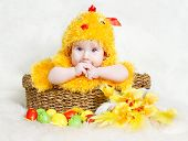 stock photo of baby chick  - Baby in Easter basket with eggs in chicken costume - JPG
