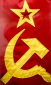 foto of hammer sickle  - Hammer and sickle and star on an old flag from the U - JPG