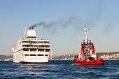 Cruise ships with a tug boat