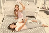 Girl Child Sit Split In Bedroom. Friends Gymnasts Support Each Other. Sport Lifestyle. Girl Kid Paja poster