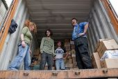 Volunteers From Book-cycle, The Uk Volutary Run Charity Based In Exeter, Uk, Load A Container With D