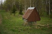 Wooden Well Water On The Background Of The Summer Forest. Wooden Well With   Roof. Single Water Well poster