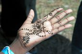 stock photo of haldi  - Work of tattoo artist on hand in India motif - JPG