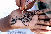 pic of haldi  - Work of tattoo artist on hand in India motif - JPG