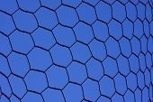 picture of chicken-wire  - hexagon shaped chicken wire fence against a bright blue sky - JPG
