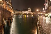 Chapel Bridge (Kappelbr�cke) with Jesuit Church at night, Lucerne, Switzerland