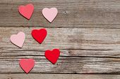 red hearts on wood with copy space
