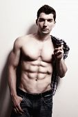 Sexy masculine man with muscular abdomen